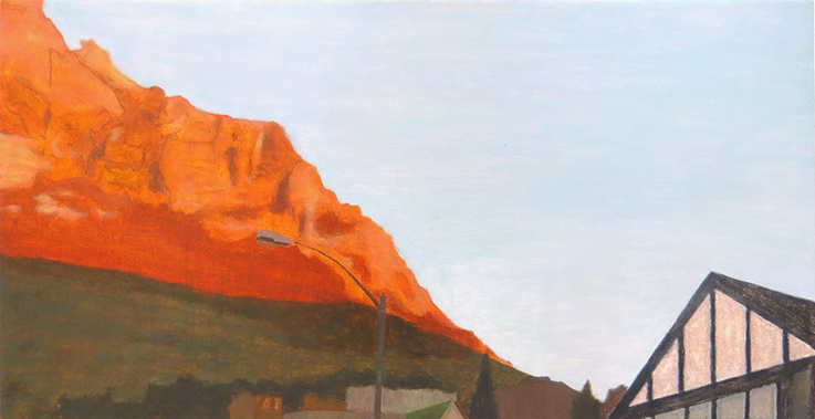 Orange, morning-sun mountain with street lamp and a peaked roof