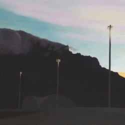 Silhouette of the Good Hope Centre and Table Mountain at twilight