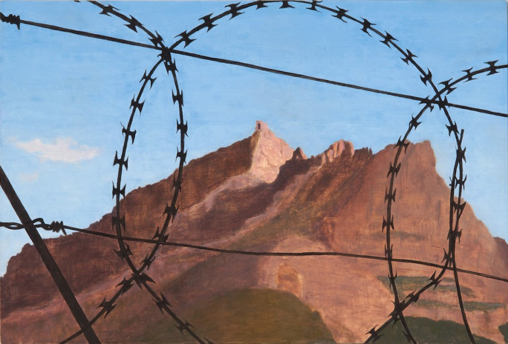 Table Mountain seen through barbed wire in Cape Town's city bowl