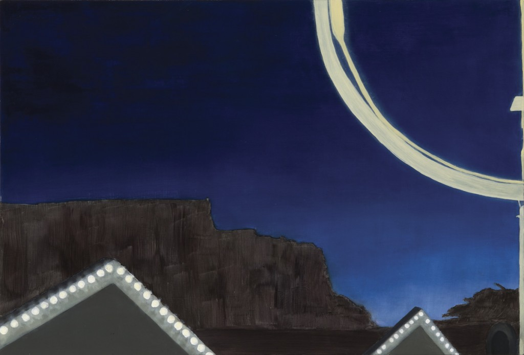Nighttime sky with illuminated triangular rooftops and Table Mountain in the background